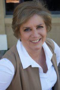 Beth-Headshots-brown-jacket-seated--200x300